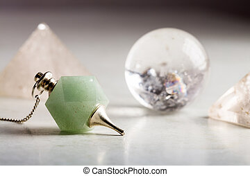 crystal ball, rock crystal pyramid and Pendulum