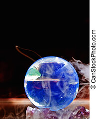 Crystal Ball surrounded by mist on black