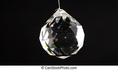 crystal bowl swinging on a black background