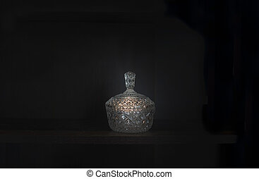 Crystal bowl with lid against dark background.