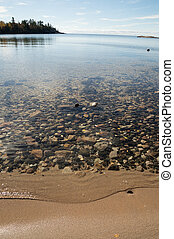 Crystal clear Lake Superior Beach with sand and rocks
