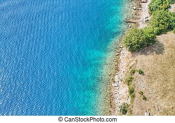Crystal clear ocean water in Croatia near Krk