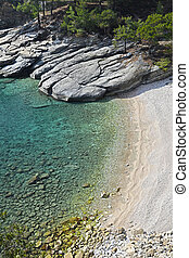 Crystal clear - The crystal clear waters of a small bay at...