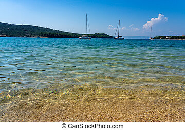 Crystal clear turquoise water in Cres Island Croatia at the ...