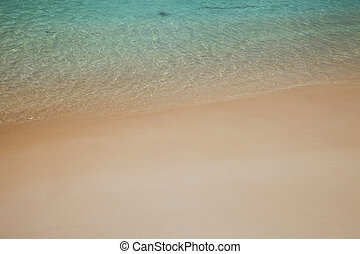 Crystal clear watersurface at the beach