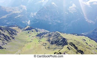 Crystal floor suspended of Thrill walk on Schilthorn, Canton of Bern. Spectacular landscape with snow-capped peaks of Bernese Prealps at Birg above Murren in Switzerland. Summer season.