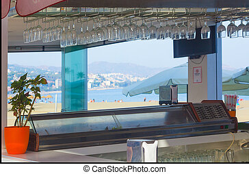 crystal glasses adorning the roof of a beach cafe