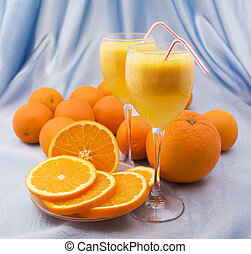 Crystal glasses of fresh orange juice