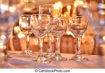 Crystal glasses on the table / close up of many champagne glasses on a special event