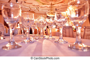 Crystal glasses on the table / Many empty glasses on a table, closeup