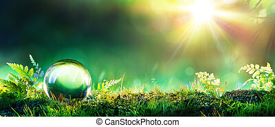 Crystal Green Globe On Moss - Environmental Concept