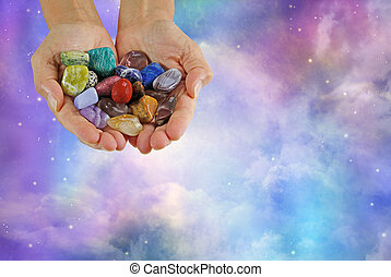 Crystal healer Offering selection of tumbled healing stones