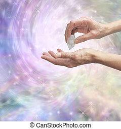 Crystal healer sensing energy