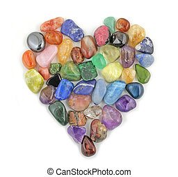 A Love Heart formed from tumbled precious stones on a white background