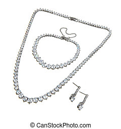 crystal pendant, bracelet and a couple of earrings isolated on white