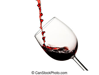 Crystal wine glass with pouring red wine