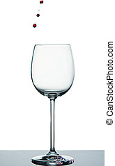 Crystal wine glass with red wine drops