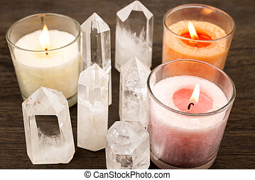 Quartz crystals aligned and lighted color candles