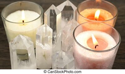 Crystals and candles - Quartz crystals aligned and lighted ...
