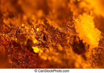 Crystals on Abstract Orange background. Extreme closeup. ...
