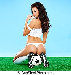 csábító, női, futball játékos, alatt, egy, erotikus, póz