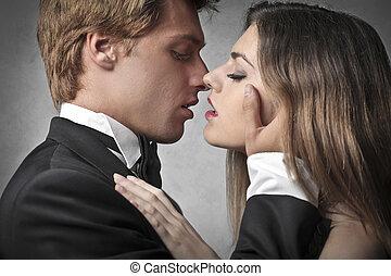 csókol