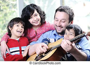 család, együtt, gitár, otthon, játék, boldog
