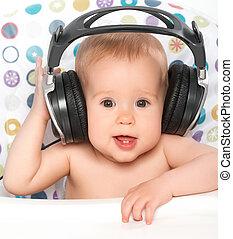 csecsemő, fejhallgató, zene hallgat, boldog
