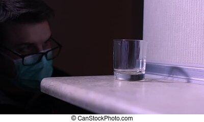 CSI Expert at crime scene loking fingerpints on a glass 1