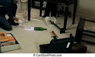 CSI Gathering Evidence - A pretty African American CSI agent...