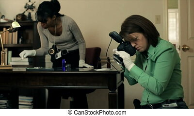 CSI taking crime scene photos - A team of CSI detectives...