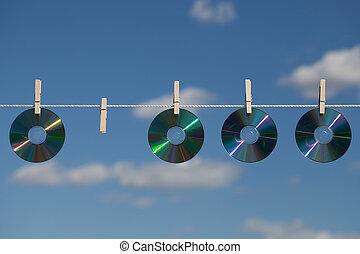 cuatro, clotheslines, cds