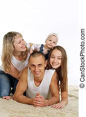 cuatro, feliz, acostado, familia , gente