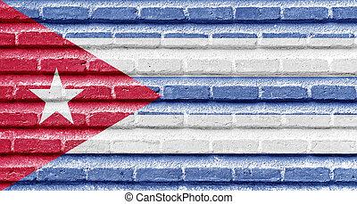 Cuba flag on an old brick wall