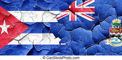 Cuba flag with Cayman islands flag on a grunge cracked wall