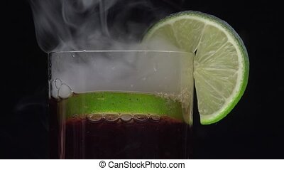 Cuba libre and dry ice smoke - closeup with black background