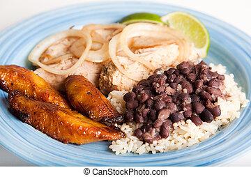 Cuban Cuisine - Traditional Cuban meal, of roast pork, black...