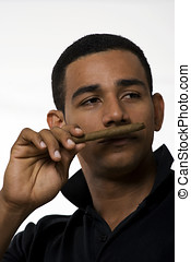 Cuban man smelling cigar