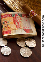 Cuban Money On A Desktop With A Panama Hat And Cigar