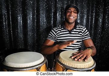 Cuban percussionist - Portrait of young latino percusionist ...