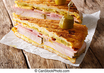 Cuban sandwich Cubano close-up on the table. horizontal