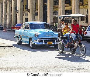 Cuban transport - HAVANA-Feb 2: A taxi-bike and a vintage...