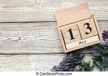 cube calendar for may 13th on wood with copy space