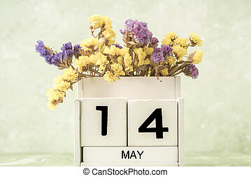 cube calendar for may on green with copy space