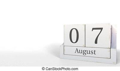 Cube calendar shows August 7 date. 3D animation - Wooden...