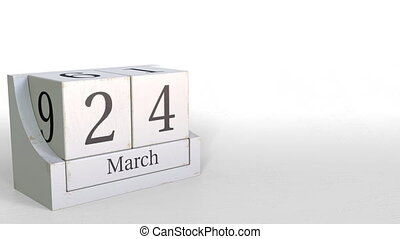 Cube calendar shows March 24 date. 3D animation - Wooden ...