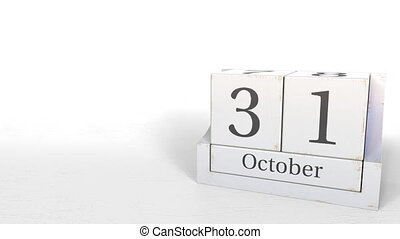 Cube calendar shows October 31 date. 3D animation - Wooden...