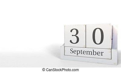 Cube calendar shows September 30 date. 3D animation - Wooden...
