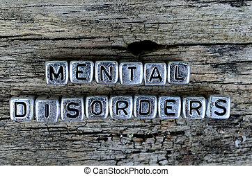 cube letter word mental disorders on wooden