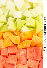 Bite size melons and honeydews over white background